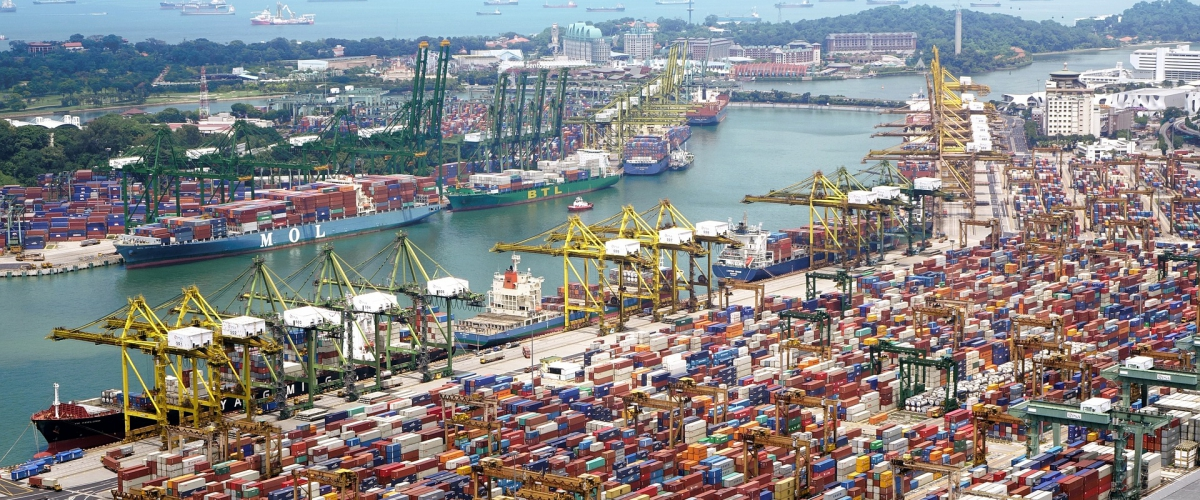 Aerial shot of very busy port full of shipping containers