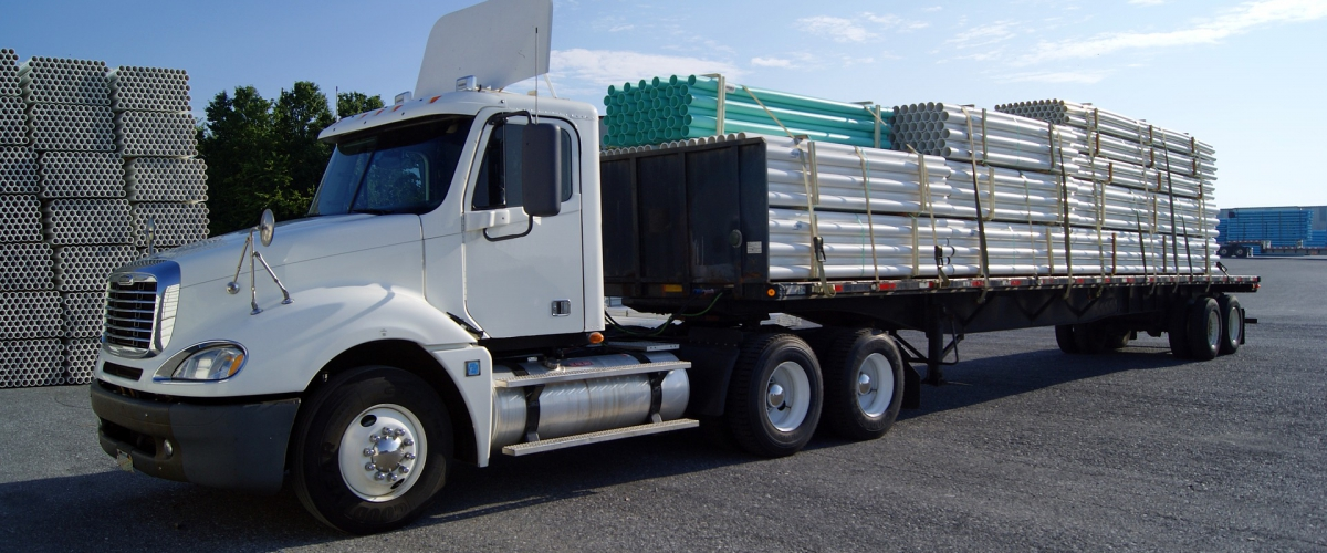freight truck loaded with cylinders