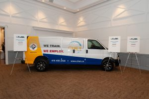 van inside carpeted convention hall