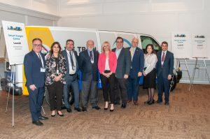 nine pose in front of van