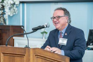 smiling speaker at podium