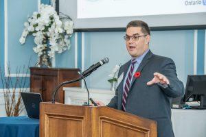 speaker at podium, hand gesture