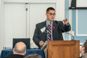speaker at podium, gestures